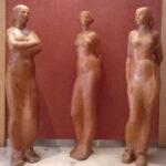 Félix Reyes CONJUNTO ESCULTÓRICO TRES MUJERES  Madera de pino oregón. 170 x 40 x 30 cm. 2001